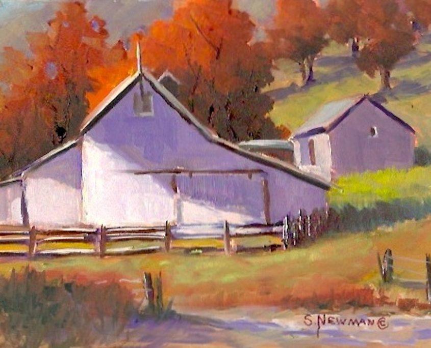 A historic white stone barn near St. Onge