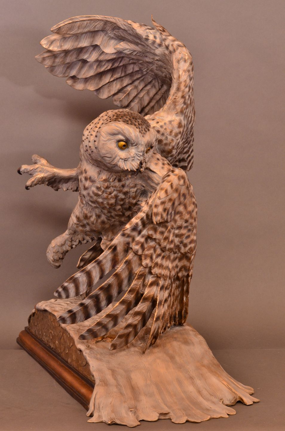 A bronze sculpture by Jim Green of a female Snowy Owl in flight.