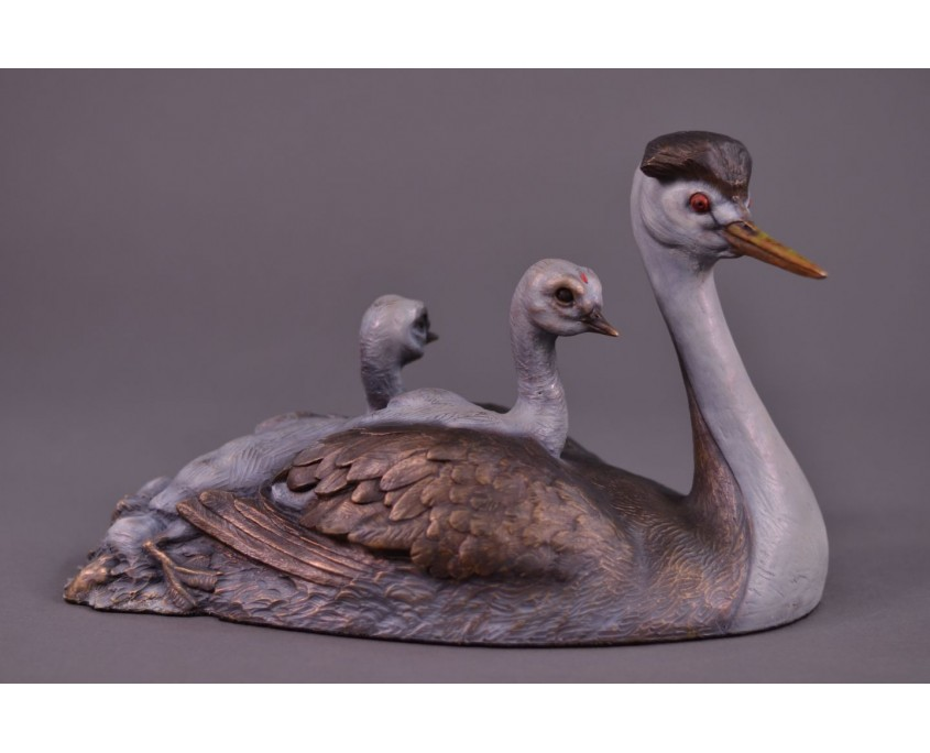 A bronze sculpture by Jim Green of a family of Clark's Grebes