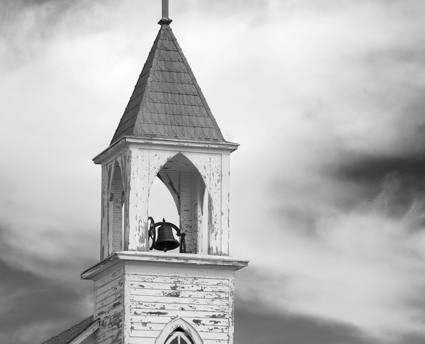 This photograph was taken by Amy Lehman. It is a black and white photo of an abandoned church in western South Dakota. It shows the promise of faith from a time long ago.